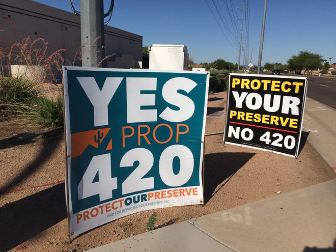 It's hard to tell the Proposition 420 signs apart.