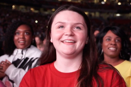 Mikayla Lowry at Jay-Z and Beyonce concert, where she was awarded a $100,000 college scholarship.