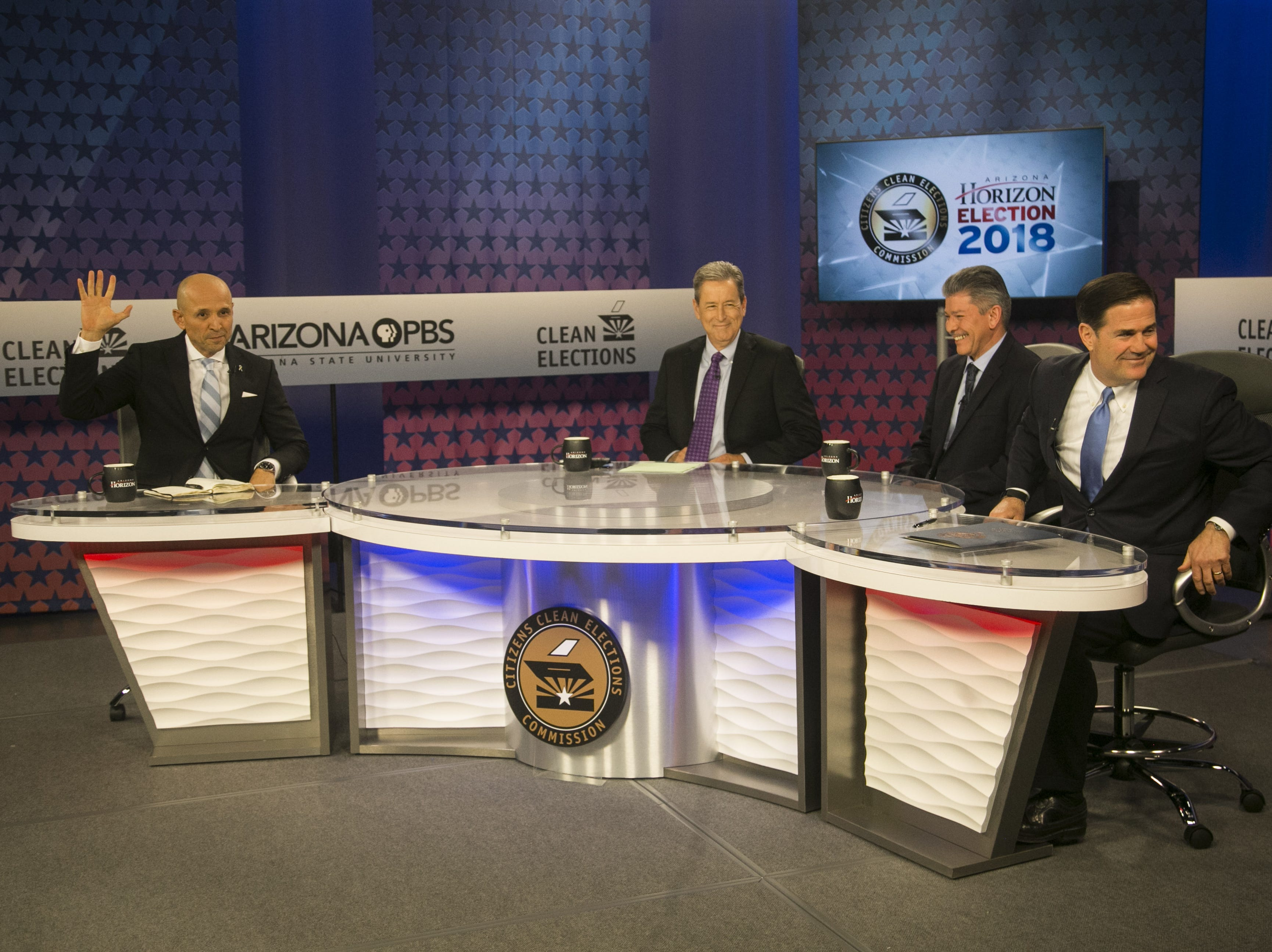 Gubernatorial candidates David Garcia (left), Angel Torres (second from right), and Gov. Doug Ducey (right) prep for their debate with host Ted Simons (center) before the gubernatorial debate on PBS inside ASU's Walter Cronkite School of Journalism and Mass Communication in Phoenix on Sept. 24, 2018.