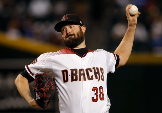Arizona Diamondbacks starting pitcher Robbie Ray delivers against the Los Angeles Dodgers during the first inning of a baseball game, Monday, Sept. 24, 2018, in Phoenix.