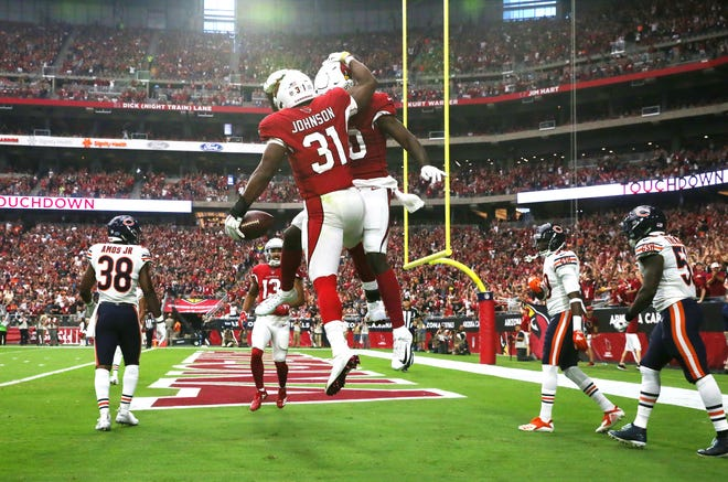 Arizona Cardinals David Johnson (31) celebrates his first-half touchdown against the Chicago Bears at State Farm Stadium in Glendale.