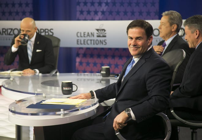 Gov. Doug Ducey looks back as a journalist asks a question before the Sept. 24, 2018. gubernatorial debate on PBS inside the Walter Cronkite School of Journalism and Mass Communication in Phoenix.