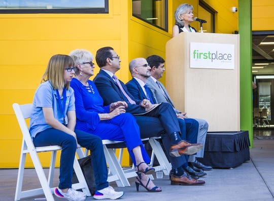 Denise Resnik, First Place AZ founder, at podium, speaks about First Place Phoenix , a $15.4 million facility combining apartments, a residential training program and a global leadership institute.  The facility provides housing options for special populations, especially autism.