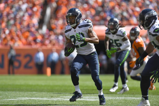 Seattle Seahawks free safety Earl Thomas (29) returns a interception in the first quarter versus the Denver Broncos at Mile High on Sept 9, 2018 in Denver, CO. Mandatory Credit: Ron Chenoy-USA TODAY Sports