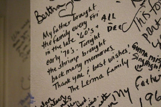 Customers have been writing notes on the walls of the restaurant's lobby since the owners announced it will be closing.