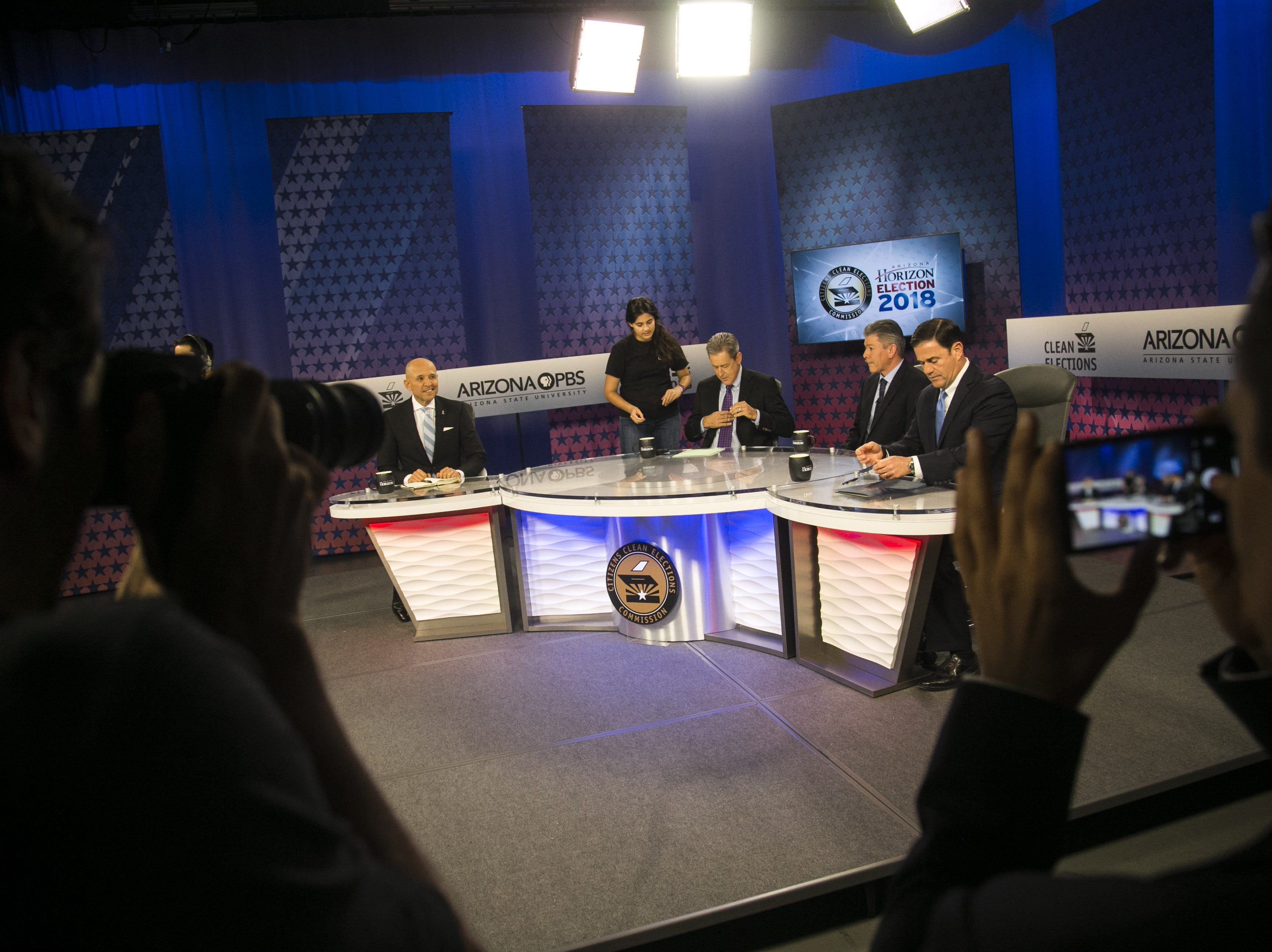 Candidates David Garcia (left), Angel Torres (second from right) and current governor Doug Ducey (right) prep for their debate with host Ted Simons (center) before the gubernatorial debate on PBS inside the Walter Cronkite School of Journalism and Mass Communication on Sept. 24, 2018.