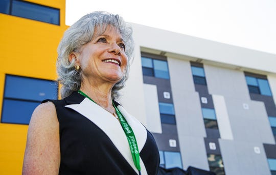 Denise Resnik, First Place AZ founder, stands outside First Place Phoenix , a $15.4 million facility combining apartments, a residential training program and a global leadership institute.  The facility provides housing options for special populations, especially autism.
