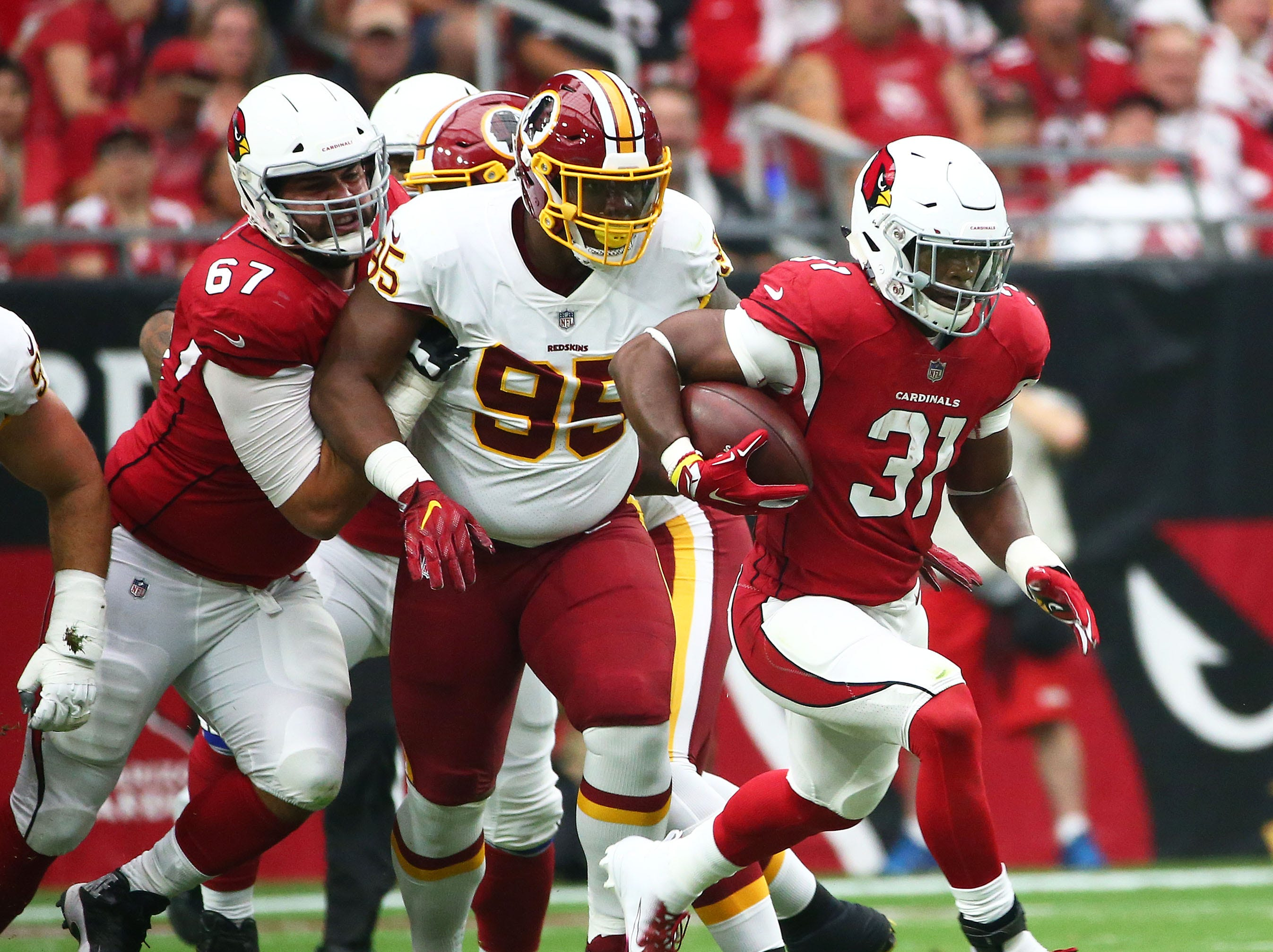 Arizona Cardinals running back David Johnson runs the ball against the Washington Redskins in the first half at State Farm Stadium.