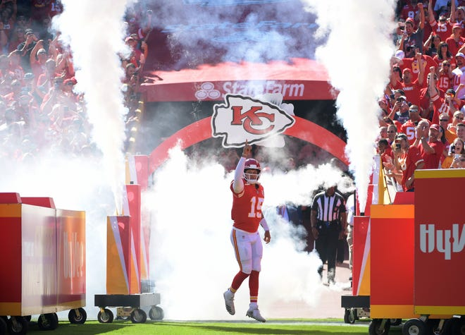 Kansas City Chiefs quarterback Patrick Mahomes (15) is introduced before the game against the San Francisco 49ers at Arrowhead Stadium.