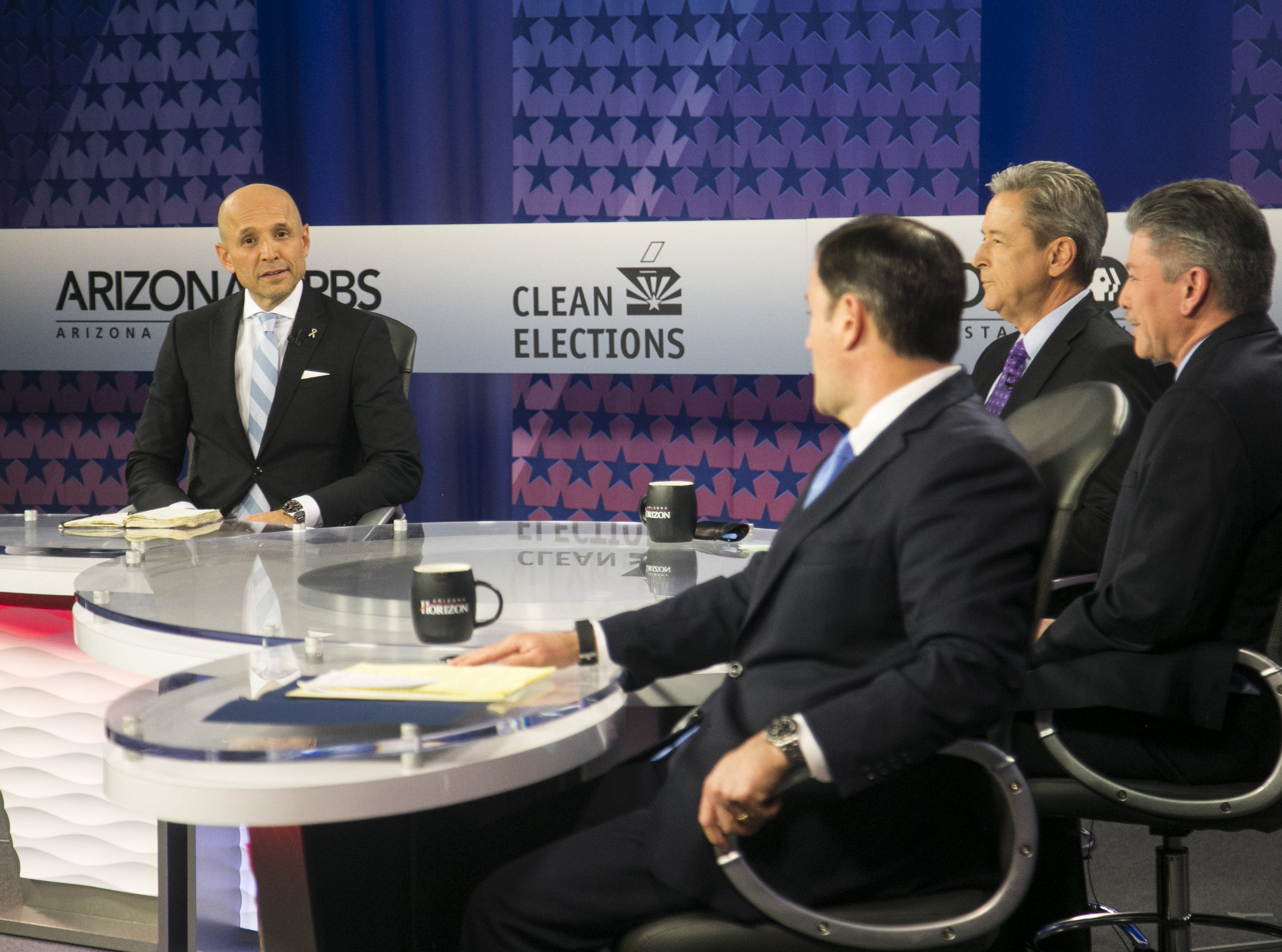 Gubernatorial candidates listen to questions from journalists before the a debate on PBS inside ASU's Walter Cronkite School of Journalism and Mass Communication in Phoenix on Sept. 24, 2018.