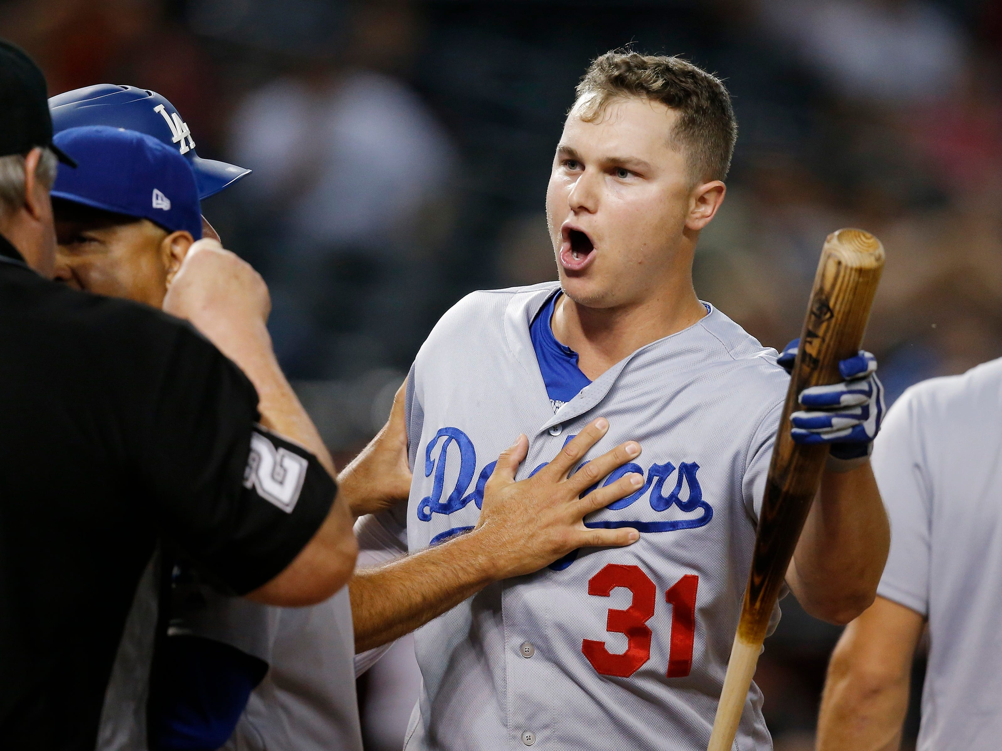 Los Angeles Dodgers' Joc Pederson (31) argues with umpire Joe West, left, after Pederson was thrown out during the ninth inning of a baseball game against the Arizona Diamondbacks, Monday, Sept. 24, 2018, in Phoenix. The Dodgers defeated the Diamondbacks 7-4. (AP Photo/Ross D. Franklin)