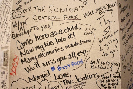 Farewell messages cover the walls inside Sing High Chop Suey House restaurant in Phoenix.