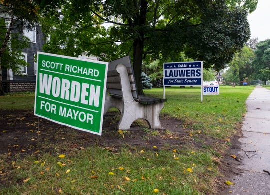 According to city officials, people and candidates putting signs in the road right-of-way and other city-owned property has become a problem.  The Department of Public Works has begun picking up signs placed illegally.