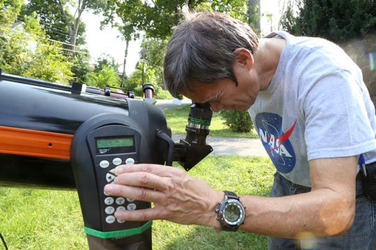 While Willie Yee looks through his telescope he makes adjustments to the scope's position on Sept. 19, 2018.