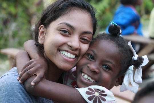 Paarul Sinha, a 2017 graduate of Vassar College, is shown in Haiti with Gina a student from a village there.