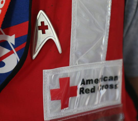 Willie Yee wears a Starfleet science badge on his American Red Cross vest at his home in New Paltz on Sept. 19, 2018.