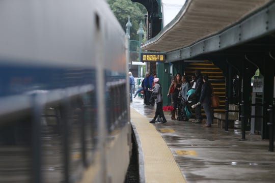 Passengers wait on the platform for a train to Grand Central at Poughkeepsie Station on Sept. 25, 2018.