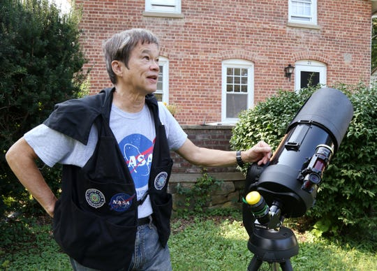 Willie Yee discusses the features of his telescope outside his home in New Paltz on Sept. 19, 2018.