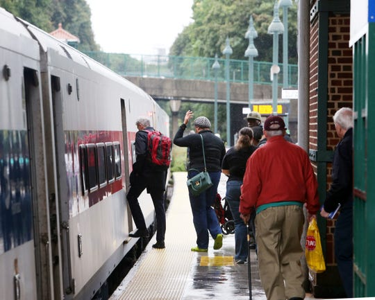Passengers board a train to Grand Central at Poughkeepsie Station on Sept. 25, 2018.