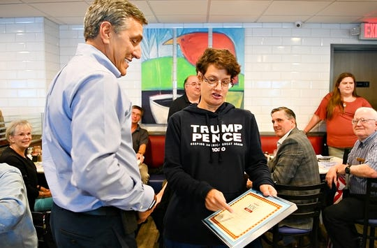 U.S. Rep. Lou Barletta, R-Pa., left, the Republican nominee for U.S. Senate against incumbent Sen. Bob Casey, is greeted by Dawn Smith, of York City, at Round the Clock Diner in Manchester Township, Tuesday, Sept. 25, 2018. Dawn J. Sagert photo