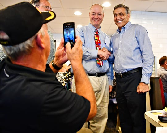 From left, Richard Isaac, of Peach Bottom Township, takes a photo of attorney Joe Gothie, of Manchester Township, as he shakes hands with Congressman Lou Barletta (R-PA), the Republican nominee for U.S. Senate, during a meet and greet lunch with area residents at Round the Clock Diner in Manchester Township, Tuesday, Sept. 25, 2018. Dawn J. Sagert photo