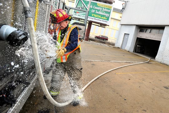 York firefighter Tim Bair releases a hose from the fire engine during a fire call Feb. 17, 2012.