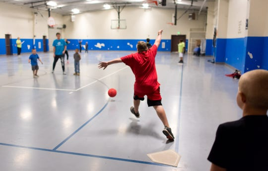 Kickball is one of the activities played in the gym.