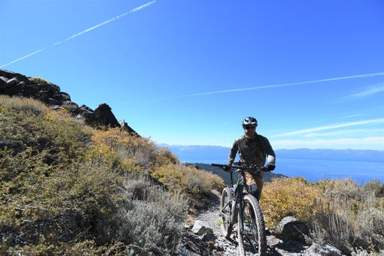 Outdoors writer Benjamin Spillman pushes his bike uphill during a ride from Spooner Summit to Genoa via Sierra Canyon on Sept. 22, 2018.