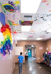 Boys and Girls club members from past years have painted the ceiling tiles in colorful designs.
