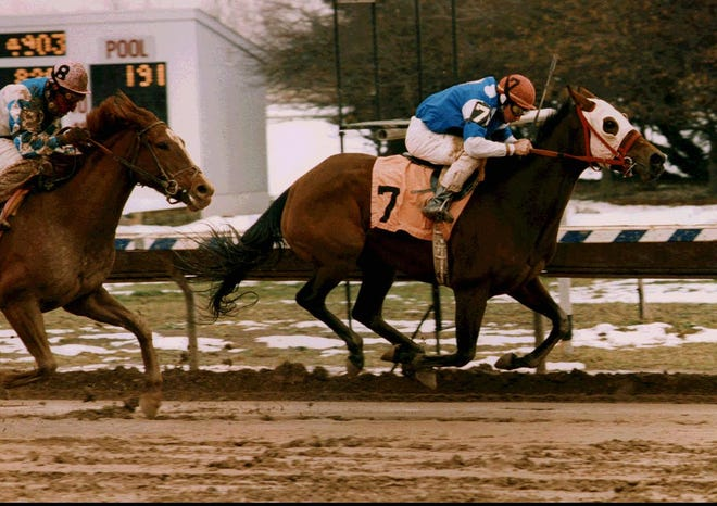 Les Hulet posts win No. 3,500 while aboard Hilary's Act at Finger Lakes Race Track in 1995.