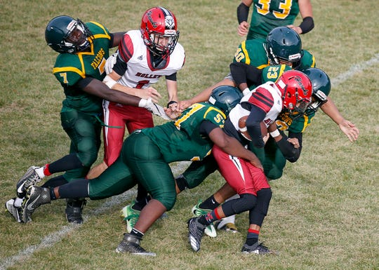 Holley's Jamel  Hildreth carries the ball during an 8-man football game at The Charles Finney School.