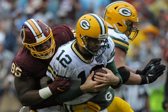Green Bay Packers quarterback Aaron Rodgers (12) is sacked by Washington Redskins defensive tackle Da'Ron Payne (95) during an NFL football game between the Green Bay Packers and Washington Redskins, Sunday, Sept. 23, 2018, in Landover, Md. He'll face a red-hot Bills pass rush this week.