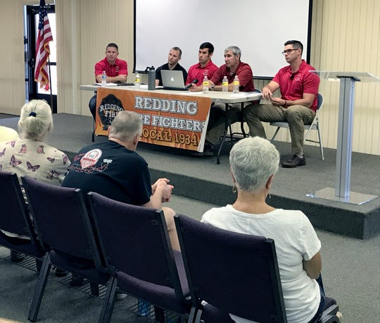 Redding firefighters, from left, Mike Henry, Ryan Nardo, Brett Morris, Matt Oliphant and Joe Hansen conduct a Carr Fire debriefing Sept. 22 with the public.