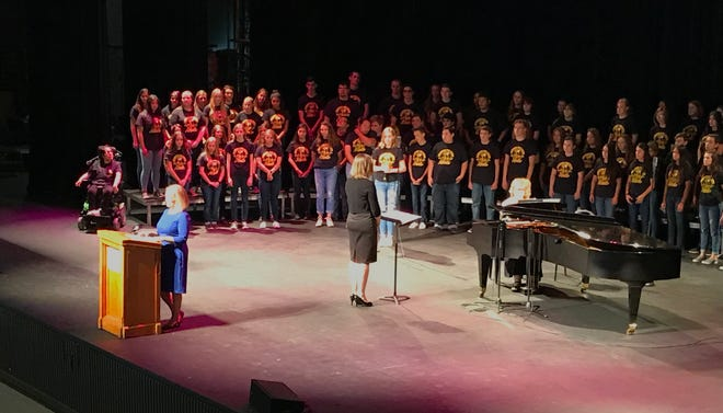The 100-member Enterprise High School Choir stands behind Redding Mayor Kristen Schreder during Tuesday's State of the City event.