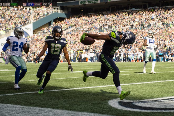 Seattle Seahawks wide receiver Tyler Lockett (16) dips his head as enters the end zone for a touchdown during the first half at CenturyLink Field.