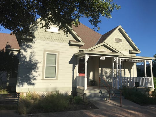 """The Zenker House — shown in Old Town San Angelo on Monday, Sept. 24, 2018 — was designed by Oscar Ruffini in 1900 in the Queen Anne """"cottage"""" style. The house was owned by Charles Zenker, a local saloon owner. In 1918, the house became apartments and later the Concho Valley Home for Girls – a shelter for troubled teens. The house was relocated to Old Town Historic District in 2002. It is occupied by the Upper Colorado River Authority."""