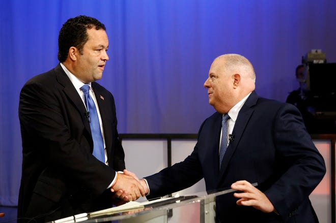 Maryland Democratic gubernatorial candidate Ben Jealous, left, and Republican candidate, Maryland Gov. Larry Hogan, shake hands before participating in a debate Monday, Sept. 24, 2018, at Maryland Public Television's studios in Owings Mills, Md.