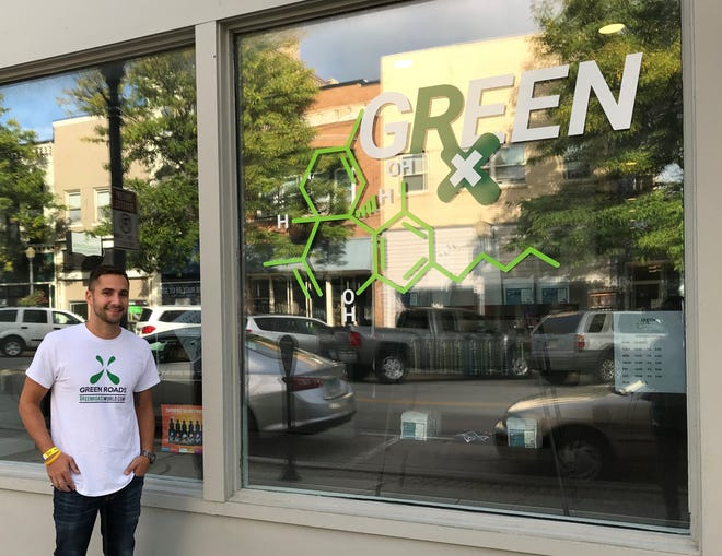 Jared Roe outside his new business, Green Rx, a shop that sells CBD-infused products.