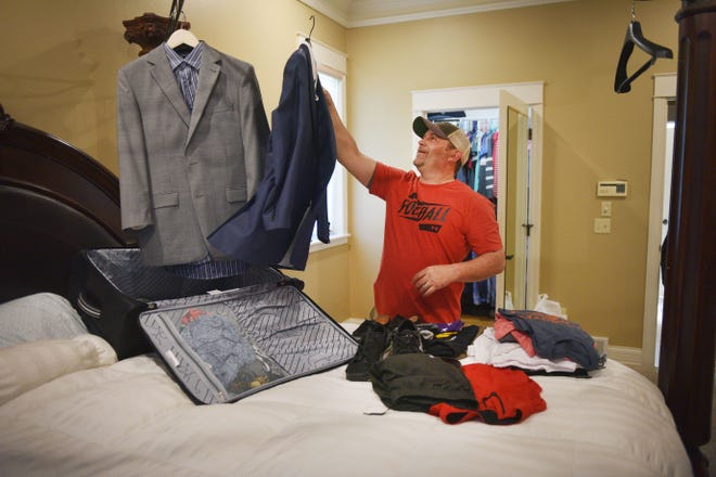 Lance Allen packs his bags Thursday, Sept. 5, at his home in Sioux Falls as he prepares to leave to donate a kidney. Allen is donating his kidney to his friend Michael Alfieri.