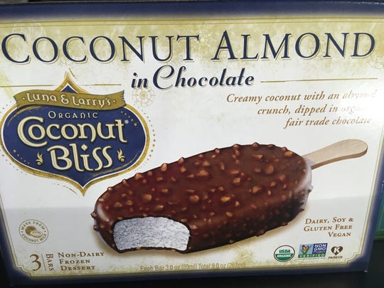 This dairy free coconut bliss ice cream bar is blissful and tastes like a frozen Almond Joy.