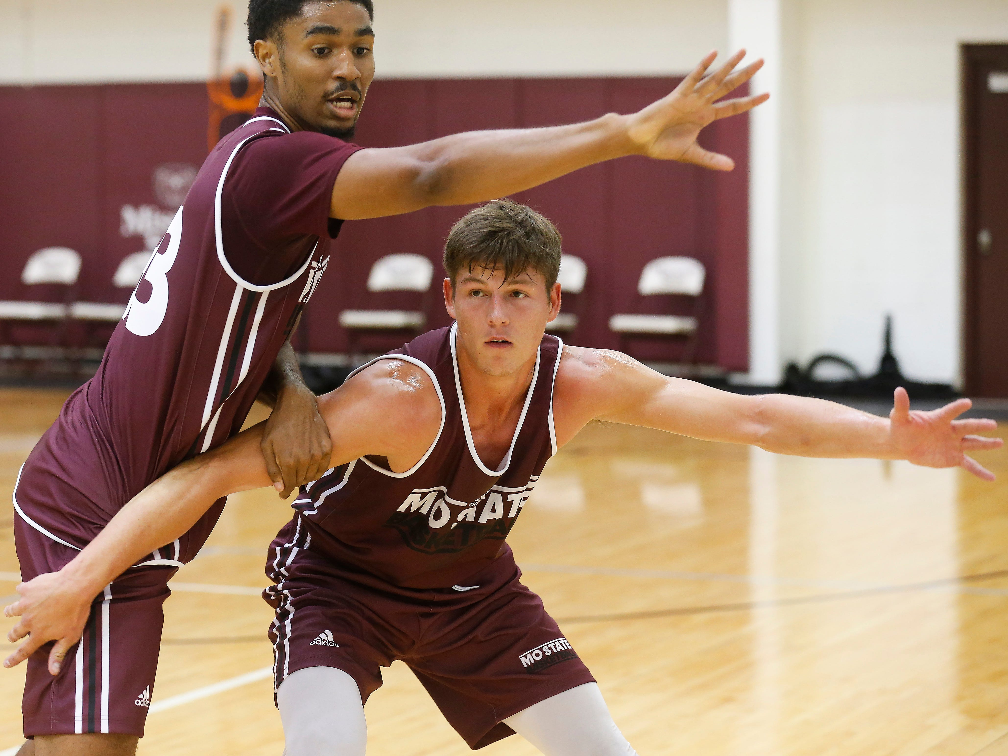 Ryan Kreklow, right, and Josh Hall run a drill during the Missouri State University men's basketball team's first practice of the season on Tuesday, Sept. 25, 2018.