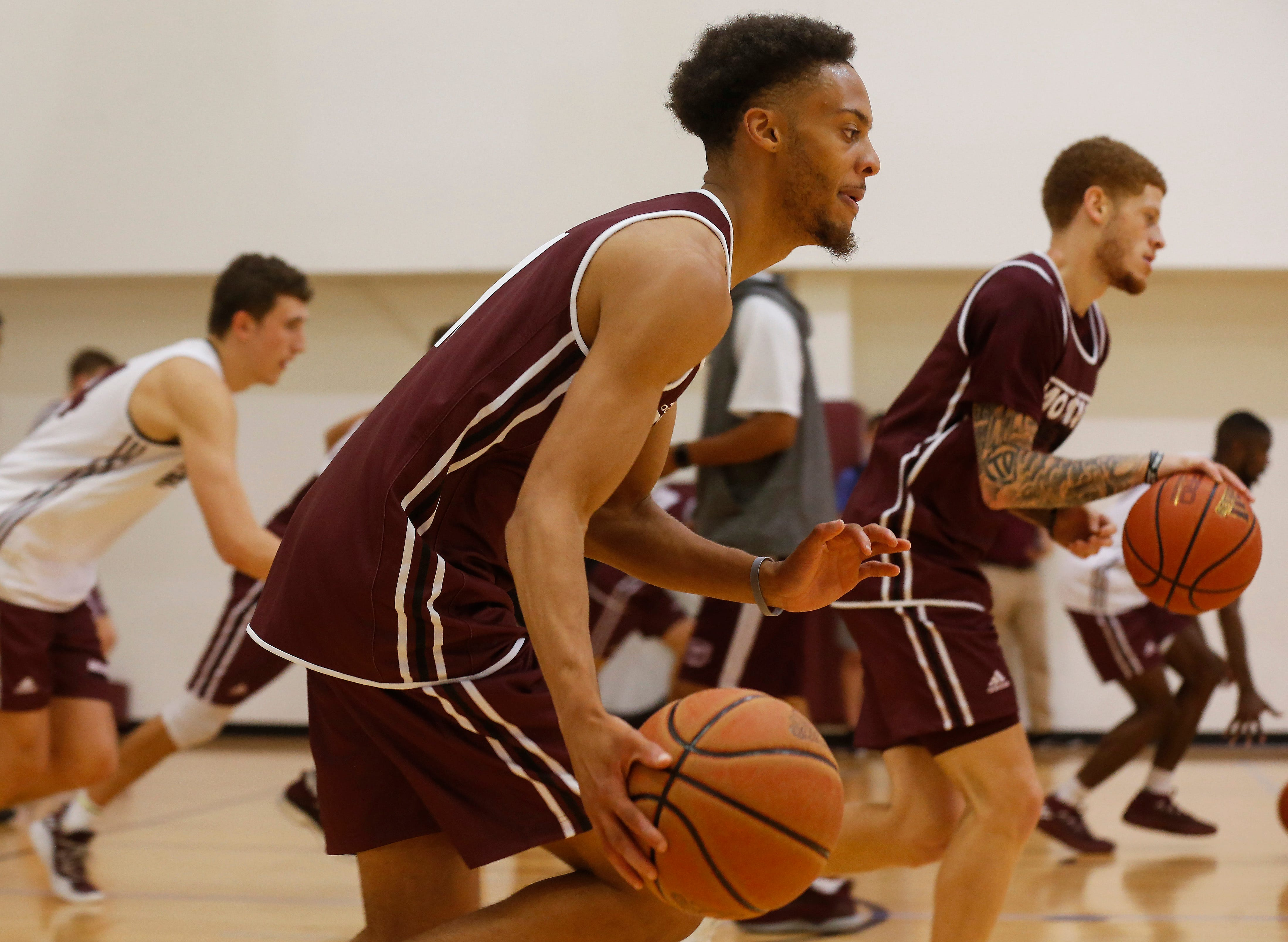 Jarred Dixon runs a drill during the Missouri State University men's basketball team's first practice of the season on Tuesday, Sept. 25, 2018.