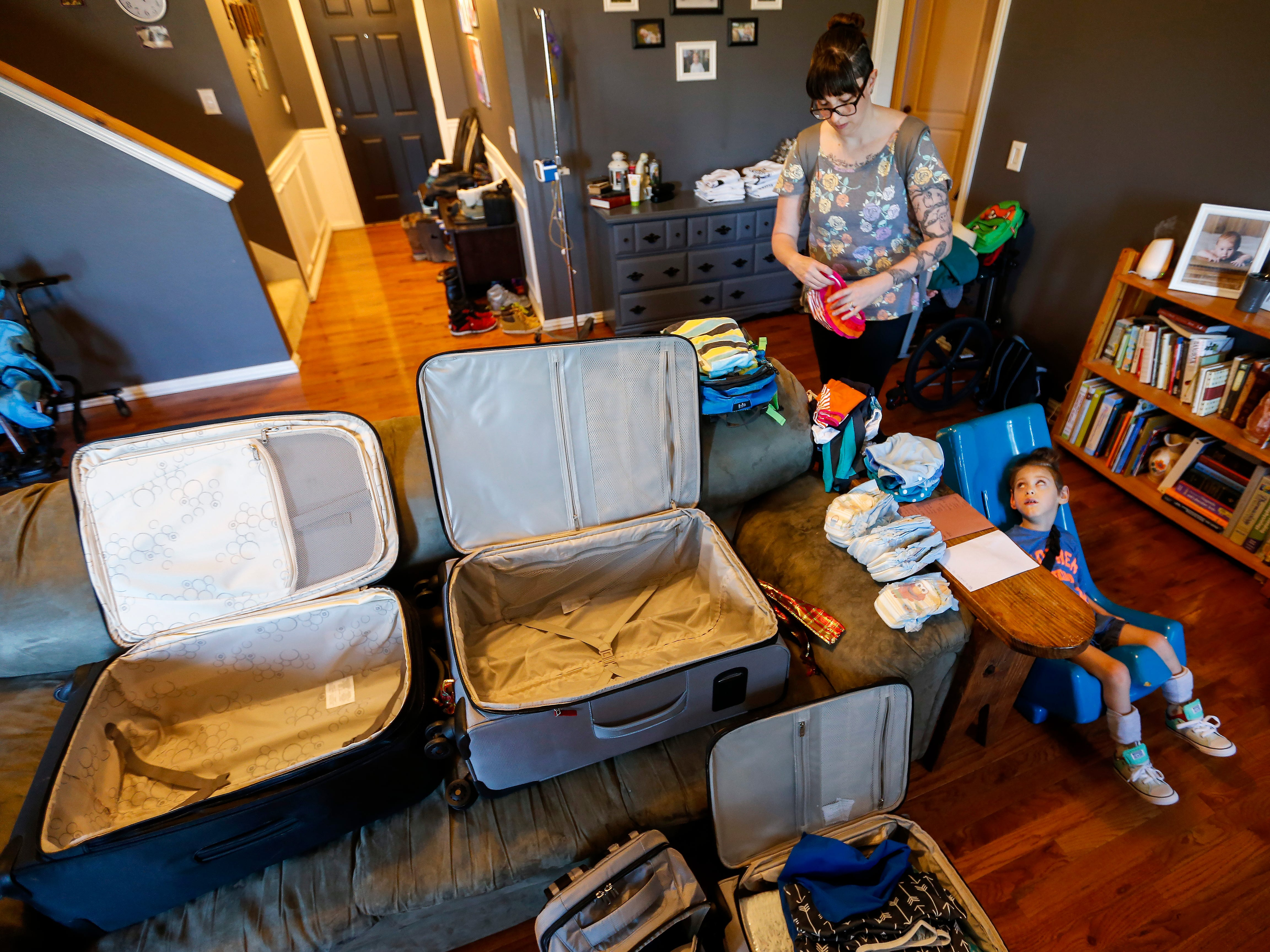Ayden Markum, 5, watches as his mom Ashley Markum packs for their Make-A-Wish trip at their home in Rogersville on Friday, April 27, 2018.