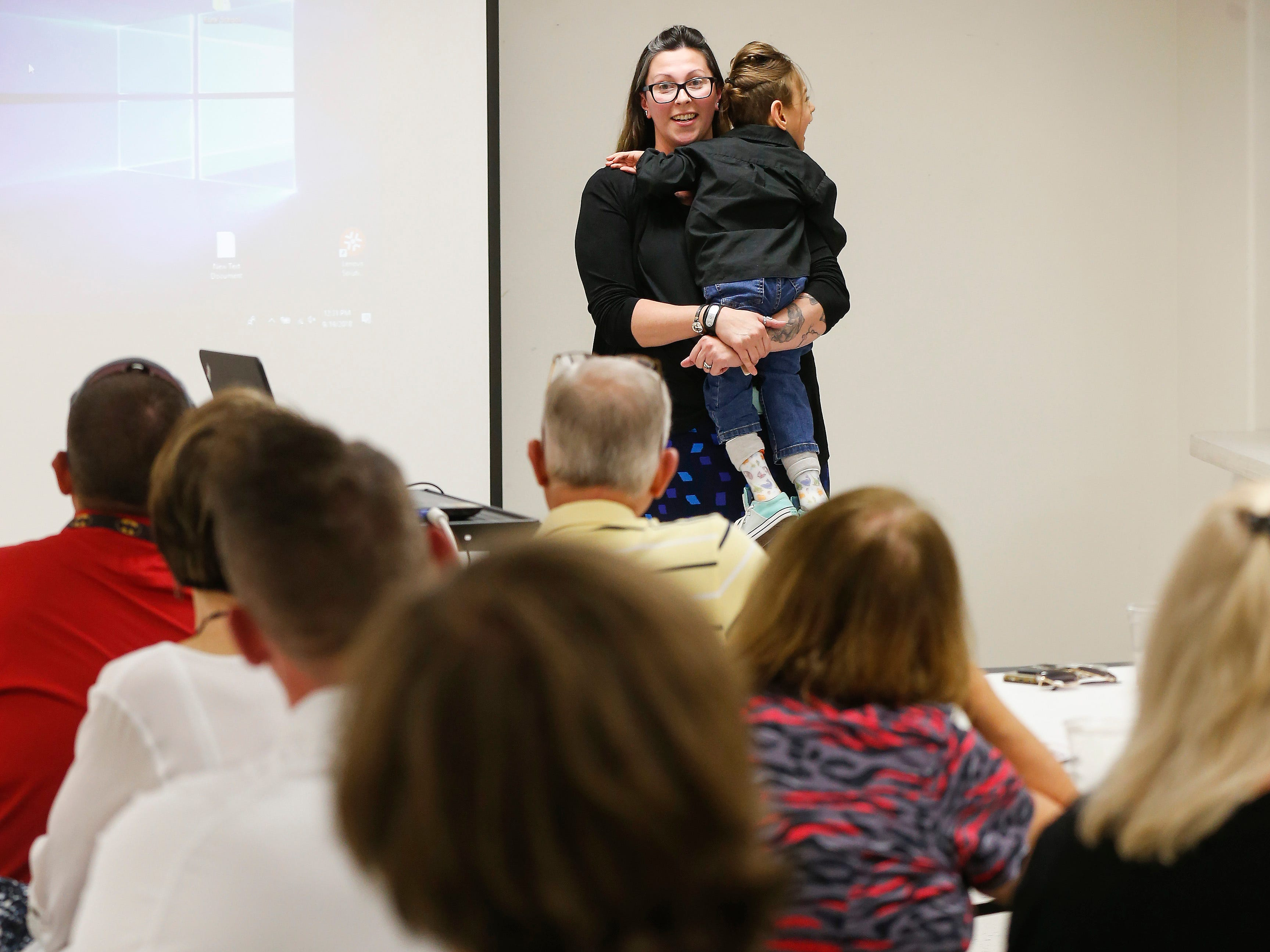 Ashley Markum holds her son Ayden Markum, 5, while speaking about their experience with CBD oil during a Rotary Club meeting at the Barry County Museum in Cassville on Wednesday, Sep. 19, 2018.