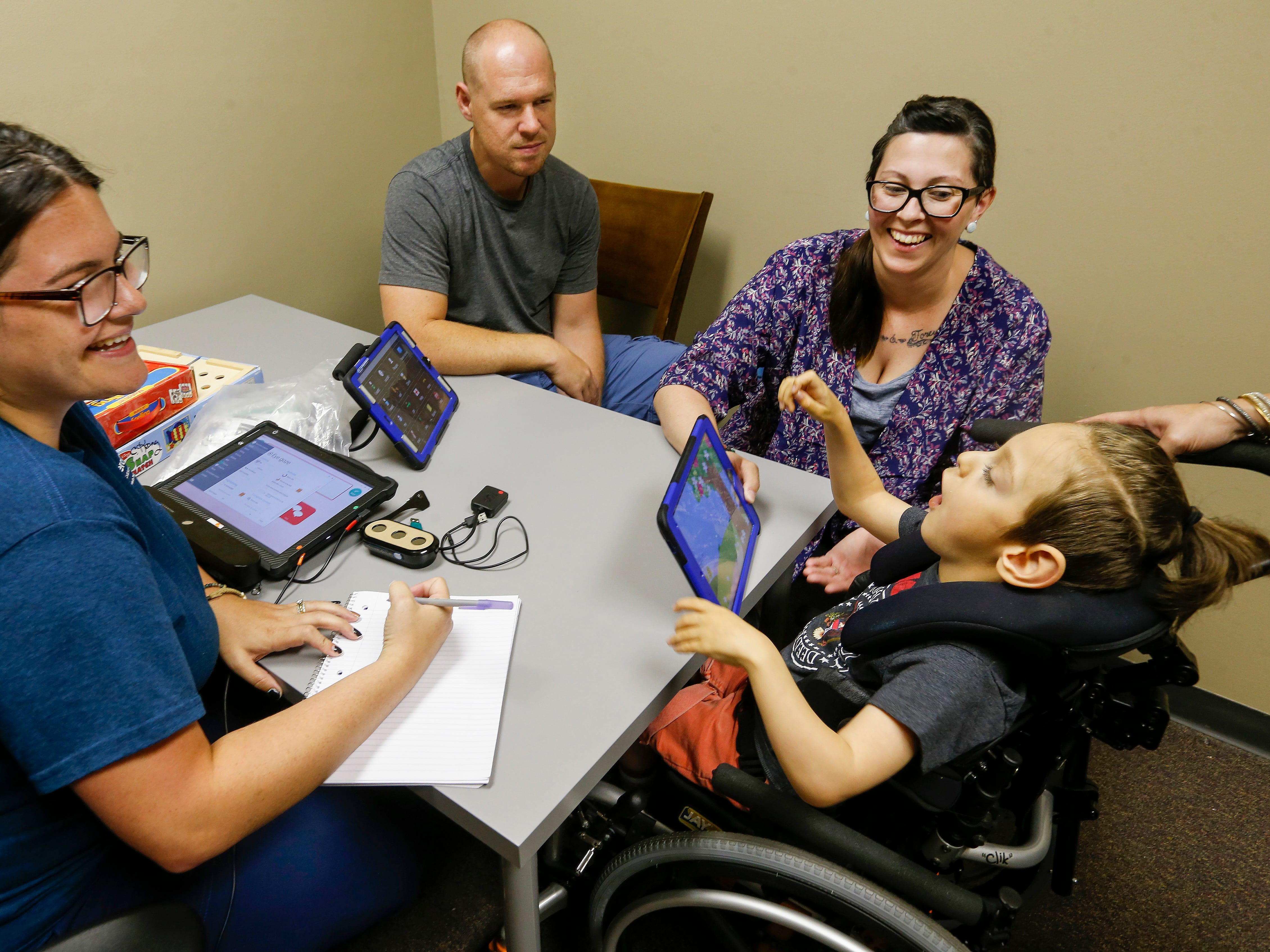 Chris and Ashley Markum meet with Allyson Beary about getting Ayden Markum, 5, an eyegaze communication device at TheraCare in Springfield on Tuesday, June 12, 2018.