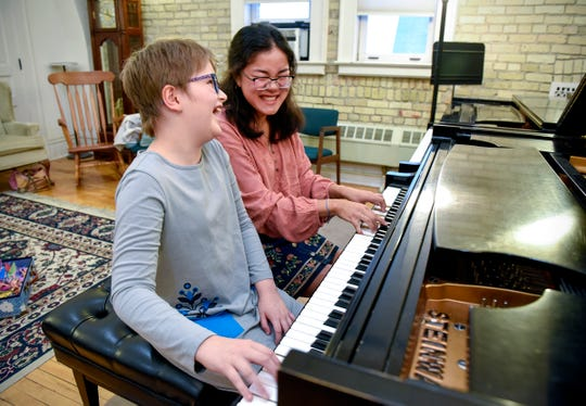 Eliana Szabo, 11,  and Cecilia Maus-Conn, 16, play together on the piano Thursday, Sept. 20, at Wirth Center for the Performing Arts where they met. Szabo had an arteriovenous malformation rupture and spent 87 nights in the Mayo Clinic in Rochester. Maus-Conn has started a nonprofit and is folding 1,000 paper cranes for Eliana as a fundraiser.