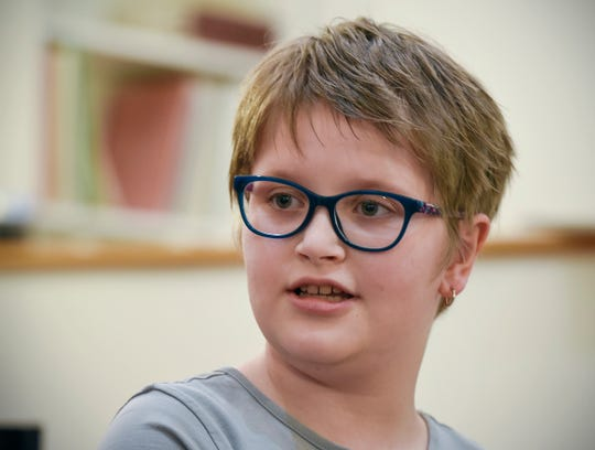 Eliana Szabo, 11, of Avon, talks about being in the hospital and her friendship with Cecilia Maus-Conn Thursday, Sept. 20, at Wirth Center for the Performing Arts.