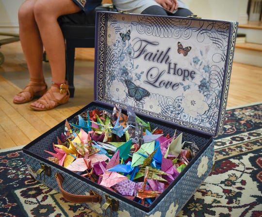 Cecilia Maus-Conn, 16, has completed 700 of the 1,000 colorful paper cranes she is folding and selling as a fundraiser for Eliana Szabo shown Thursday, Sept. 20, at Wirth Center for the Performing Arts.