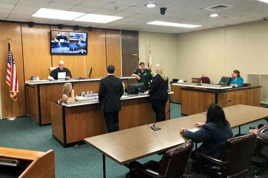 Jackson County Judge Wade Mercer agrees Tuesday to set aside pleas and vacate sentences in 49 cases brought by a former deputy accused of planting drugs on drivers. Addressing him were Assistant Public Defender Derek Blount and Assistant State Attorney Laura Parish, who announced charges would be dropped in the 49 cases.