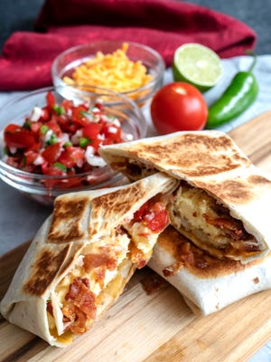 Tasty Quesadilla Breakfast Wrap is stuffed with egg, bacon and cheese.